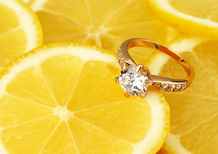 diamond ring: jewellery ring with diamond on lemon background with copy space