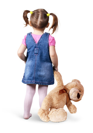 looking back: Little child girl with toy bear on white, back view