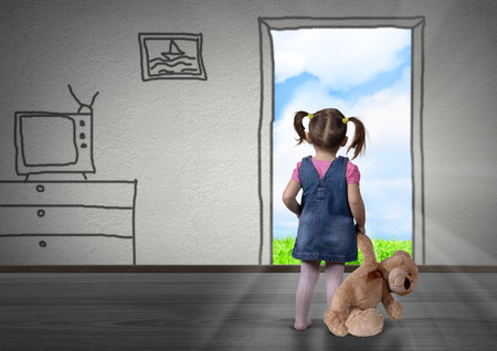 back view: Child girl in front of the drawn door, back view