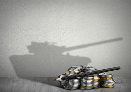 financing war concept, money with tank shadow Foto de archivo