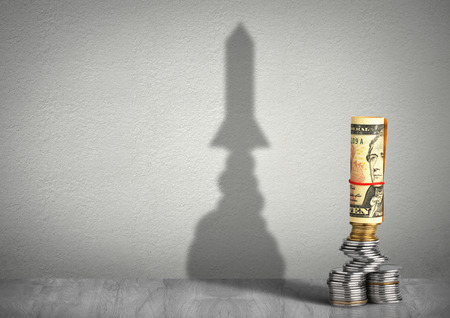 profiting: financial growth concept, money with rocket shadow Stock Photo