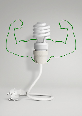 economize: Energy concept, eco lamp with wiring and hands on grey background Stock Photo