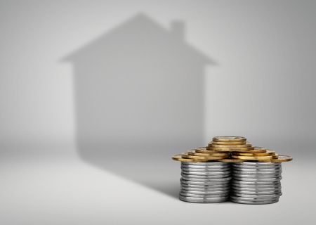 loans: real estate loans concept, money with house shadow