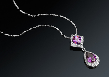 darck: jewelry pendant with gems on darck background