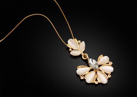 darck: Golden Jewellery pendant with diamonds on darck background