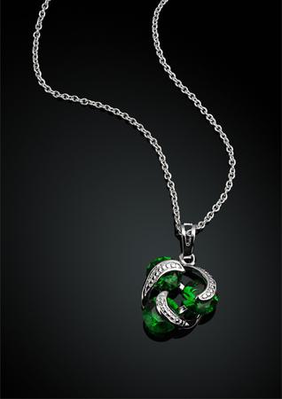 darck: jewellery pendant with green emerald on darck Stock Photo
