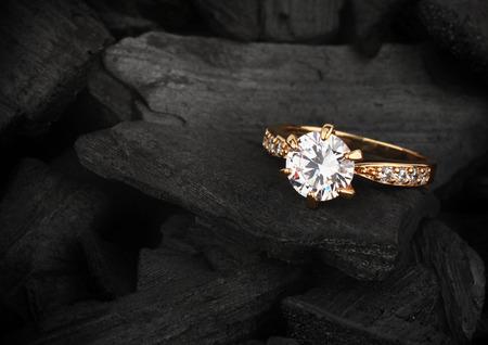 jewelry ring witht big diamond on dark coal background Archivio Fotografico