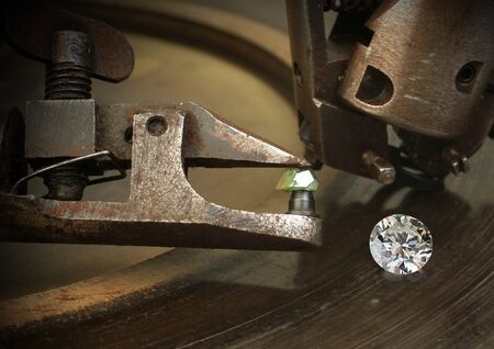 collet: Faceting diamond, big gem with jewelery cutting equipment. Stock Photo
