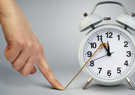 Hand stop time on clock, deadline concept