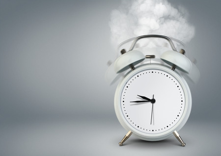 oscillate: ringing clock on grey with copy space Stock Photo