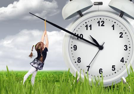 deter: Little child girl pulling hand clock, time stop concept