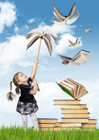 Elementary education concept , child girl with flying books Stock Photo