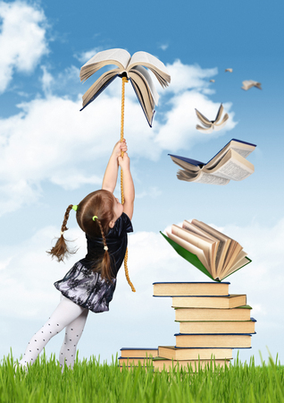 education: Education concept , child girl fly on book