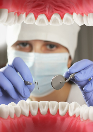 Dentist examining teeth, Inside mouth view. Soft focus