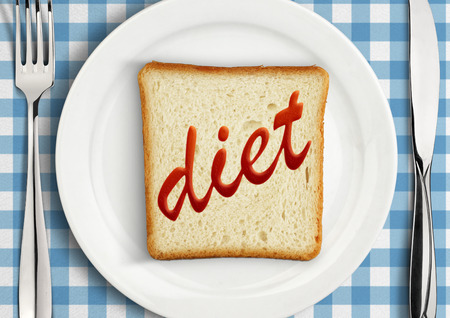 Diet concept, Table setting with slice of bread Stock Photo