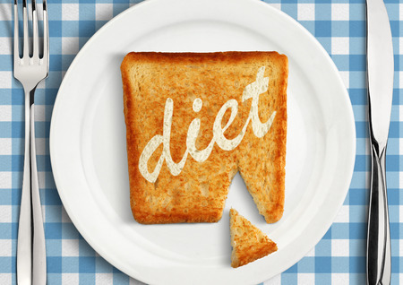 Diet concept, closeup of Table setting with fried slice of bread