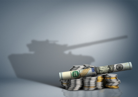 invade: military budget concept, banknote with weapon shadow Stock Photo