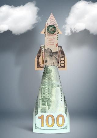 financial concept, sartup rocket made of money Stock Photo