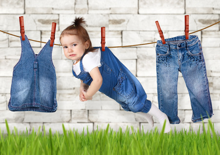 failed housework concept, Funny child hanging on clothesline