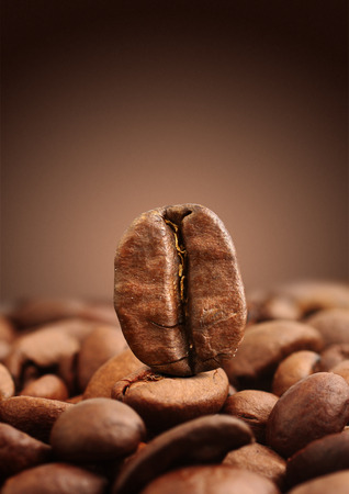 Closeup coffee bean on brown background Stock Photo