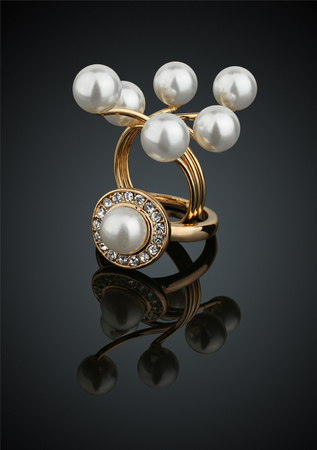 Two jewelry rings with pearls on black background  Stock Photo