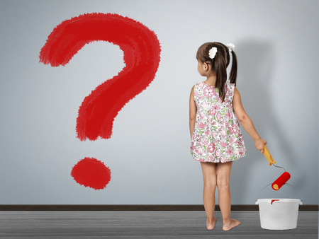 Kid question concept. Child girl draws question mark
