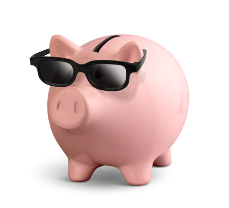 Pink piggy bank with glasses isolated on white