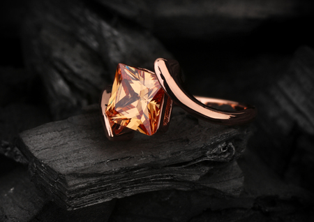 jewelry ring with big topaz gem on dark coal background