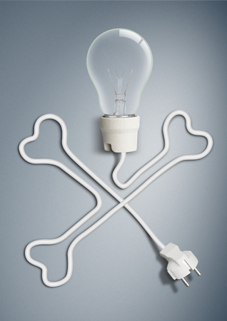 electricity concept, light bulb with cable as bone skull 版權商用圖片