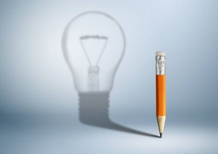 Creative idea concept, pencil with bulb shadow, copy space Banco de Imagens