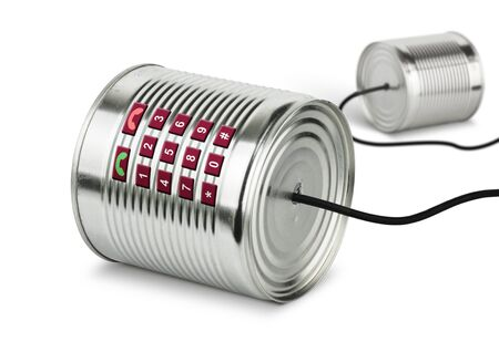 Global communication concept, old tin cans telephone Standard-Bild