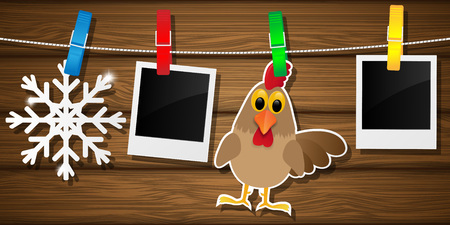 clothespeg: Blank photo frames, rooster and snowflake on a clothesline.