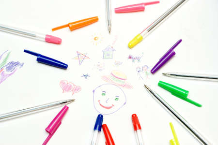 simplicity: Child paintings and colored pens. Stock Photo