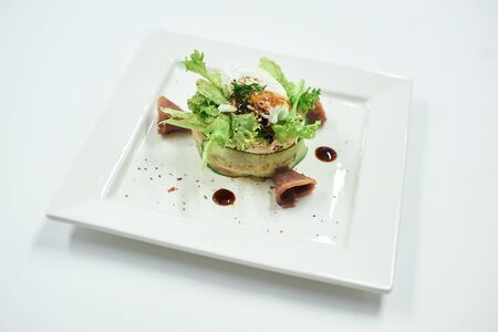 A plate of food on a white surface