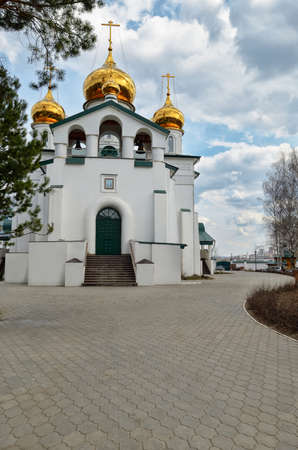old church: View of Orthodox monastery with Golden domes of the churches against the blue, cloudy sky.
