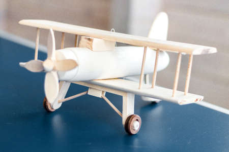 Vintage wooden airplane model. Retro style. Game model. Focus airplane Stockfoto