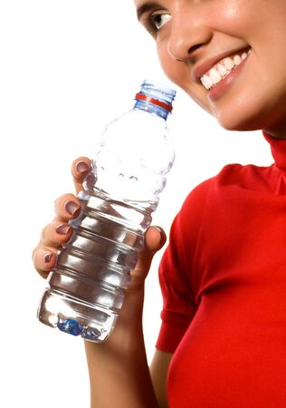 young beautiful smiling girl with mineral water (isolated on white) photo