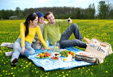 three friends taking a photo of themselves at picnic  Stock Photo