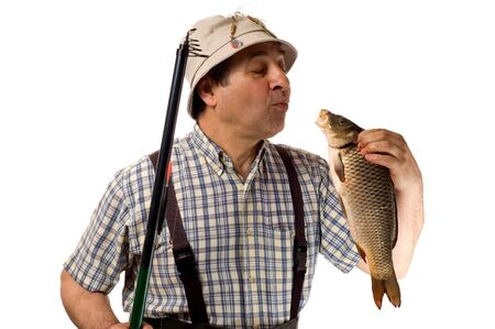 Senior fisherman with fishing rod and his catch. (isolated on white) Stock Photo - 4240296