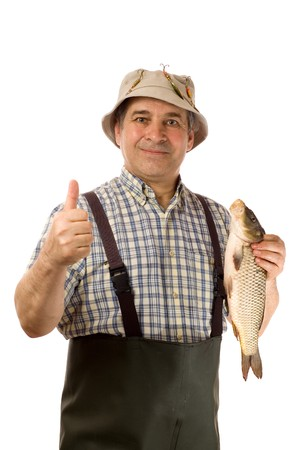 Senior fisherman with his catch, thumb up. (isolated on white) photo