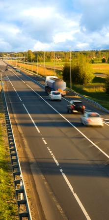 Traffic on the highway (motion blur) photo