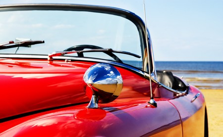 Old classic red car at beach