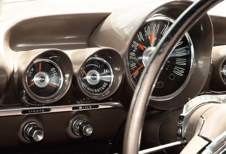 chrome wheels: View of the interior of an old vintage car  Stock Photo