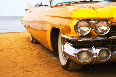 custom car: Classic yellow flame painted car at beach Stock Photo