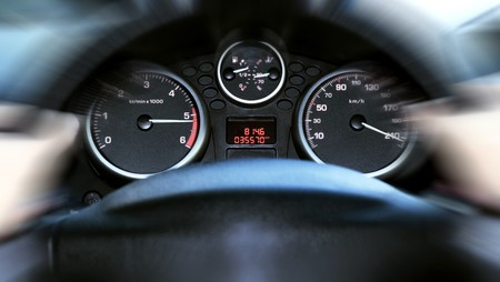 kilometer: car panel instrument speedometer and tachometer (shallow dof)