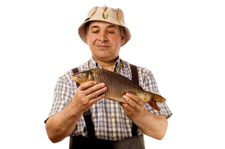Senior fisherman with his catch. (isolated on white) Stock Photo - 4281867
