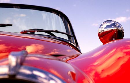 Old classic red car at beach (shallow dof) photo