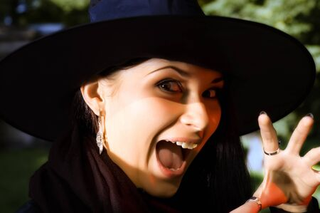 beldam: Screaming witch in hat Stock Photo