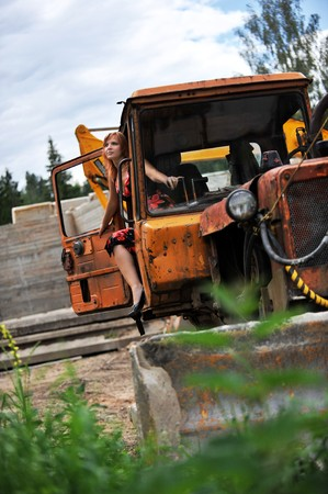 Beautiful young woman on tractor Stock Photo - 4282094