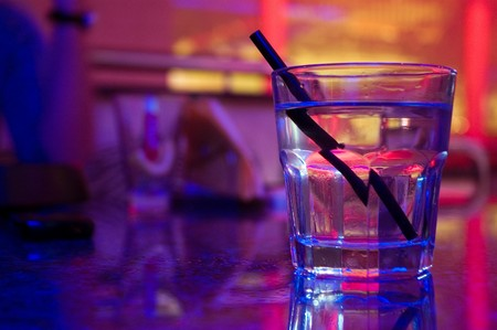 night club interior: Glass of alcohol drink in the night club Stock Photo